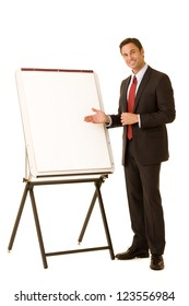 Corporate businessman wearing a suit standing with presentation easel isolated on a white background