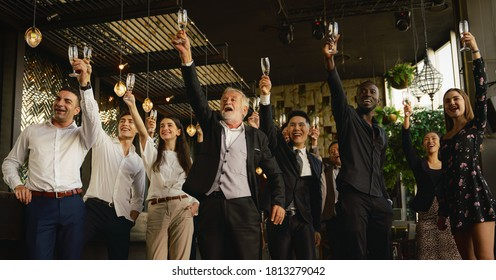 corporate businesspeople having business party toasting glasses of wine or champagne together to celebrate friendship and teamwork in special event such as corporate aniversary