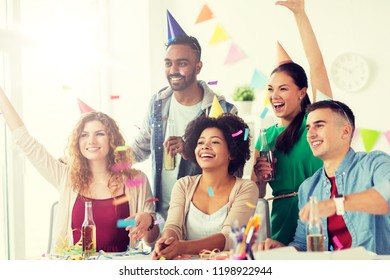 corporate, celebration and holidays concept - happy team with confetti and serpentine having fun at office birthday party