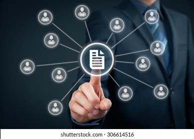 Corporate data management system (DMS) and document management system concept. Businessman click (or publish) on document connected with corporate users working on notebooks with access rights.