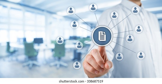 Corporate data management system (DMS) and document management system concept. Businessman click (or publish) on document connected with users working on notebooks. Wide banner, office in background.