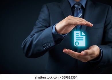 Corporate data management system (DMS) and privacy concept. Businessman with protective gesture and secured (protected) document in his hand.
