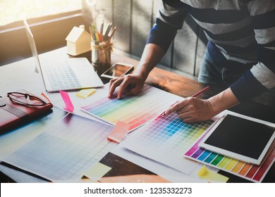 corporate designer graphic creative creativity concept ,man using pen, laptop and tablet to create graphic design coloring colour ideas style house to order customer. engineering and design.