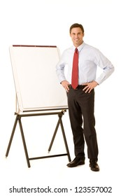 Corporate executive wearing a shirt and tie standing next to a presentation easel