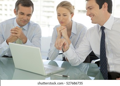 Corporate executives working together at a business meeting