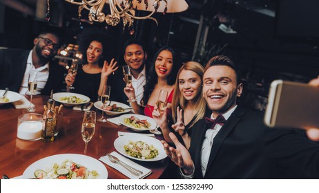Corporate Group Businessmens Meeting In Restaurant. Businessmans Having Meeting In Indoor Restaurant. Group Business People Geting Order in Restaurant. Corporate, Collaboration Concept. Make Selfie.