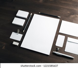 Corporate identity mockup. Blank stationery set on wood table background. Responsive design template.