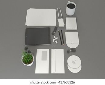Corporate identity template set mock up with tablet gadget. Business stationery mockup with white blank. On gray background. Letter envelope, card, notepad, pen, pencil, paper an. 3d illustration