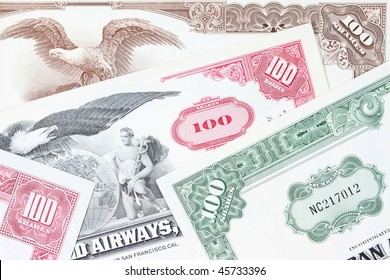 Corporate investing. Old stock share certificates from 1950s-1970s (United States). Vintage scripophily objects.