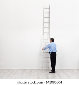 The corporate ladder - businessman at the start of carrier, begin climbing