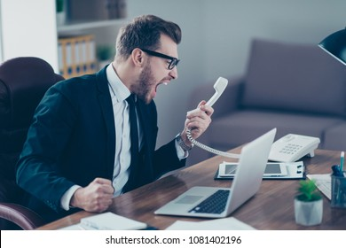 Corporate mad people yell authority tell speak with staff people person concept. Side profile view portrait of disappointed tired busy sad upset agent financier shouting on receiver in his hand