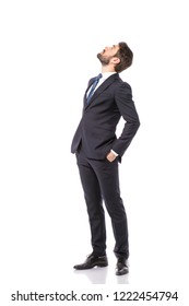 corporate man, elegant businessman standing on white background pointing and looking up