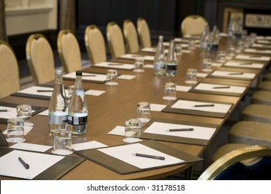 Corporate meeting room with chairs and tables.