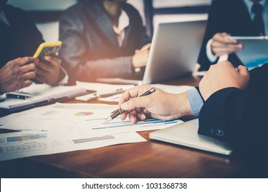 Corporate meetings, Business team organizations and investment plans at working with new startup project with chart,graph and business accessories on workplace.