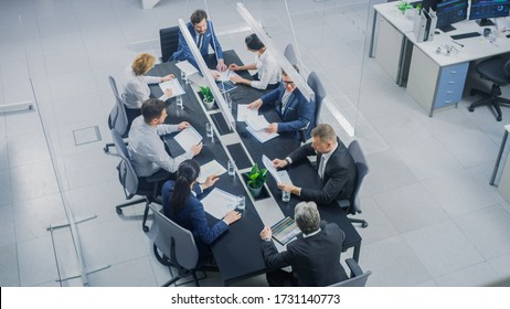 In the Corporate Office Meeting Room Group of Businesspeople, Investors, Executives and Members of the Board of Directors Talking, Negotiating and Working on a Winning Strategy. High Angle Shot