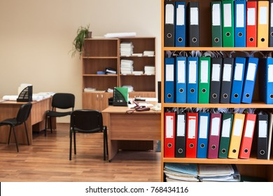Corporate office room with storage of color folders as archive or repository, nobody