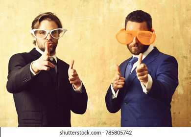 corporate party. bearded men with funny summer eyeglasses in formal business suit