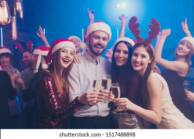 Corporate party concept! Nice attractive stylish cheerful cheery positive ladies and guys having fun chill out rest relax tradition winter season vacation December at modern luxury fogged nightclub
