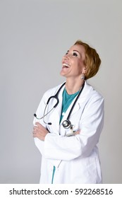 corporate portrait of beautiful and happy woman md doctor or nurse posing smiling cheerful with stethoscope in health care and hospital clinic work staff concept isolated background
