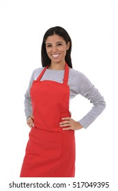 corporate portrait of young attractive hispanic home cook woman in red apron posing happy and smiling isolated on white background in chef and successful cooking