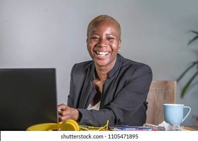 corporate portrait of young happy and successful black afro American business woman working at modern office smiling cheerful having trendy hair style in white collar job lifestyle concept