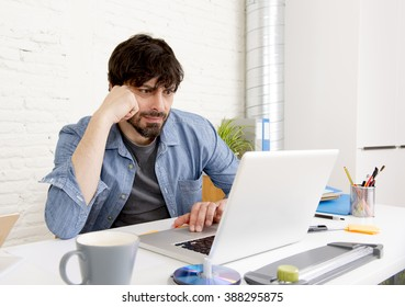corporate portrait of young hispanic attractive hipster businessman on his 30s working at modern home office with computer laptop in creative freelancer and self employed business model