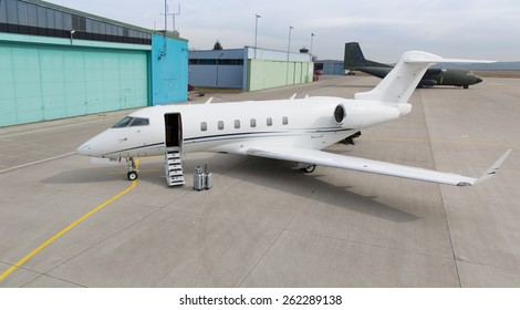 corporate private jet with luggage in front