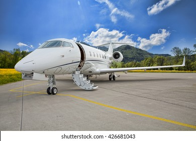 corporate private jet - plane on runway in mountains