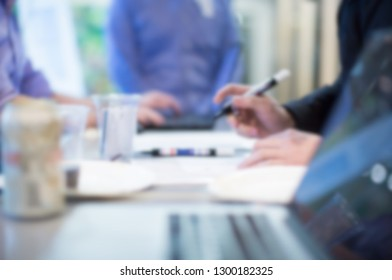 Corporate Seminar Event. Businessman Receiving Audience Sign-in. Blurred. Business Meeting. Investor Presentation Manager Accepting Attendee. Registration. Business People Working on Contract Deal.