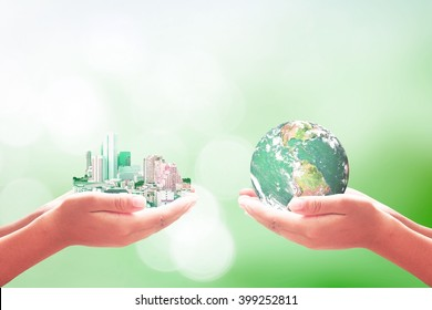 Corporate social responsibility (CSR) concept: Two human hand holding big city and earth globe over blurred green nature background. Elements of this image furnished by NASA