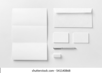 Corporate stationery set mockup. Blank white textured brand ID elements.