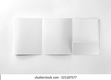 Corporate stationery set mockup. Two presentation folders and letterhead at white textured paper background.