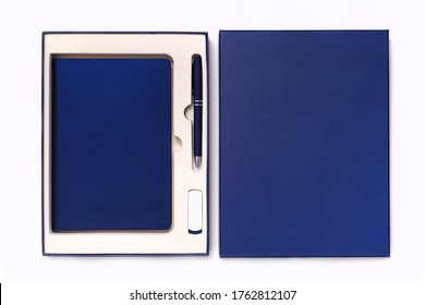 Corporate style box with pen, flash drive and notebook isolated on white background. View from above
