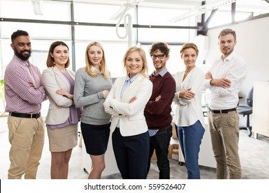 corporate, teamwork and people concept - happy business team in office