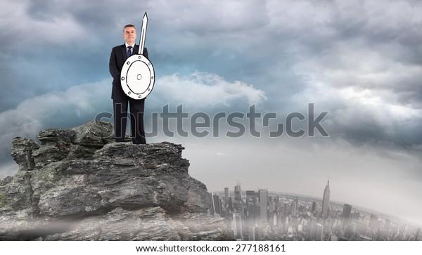 Corporate warrior against rocky landscape