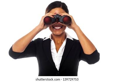 Corporate woman looking at you through binoculars