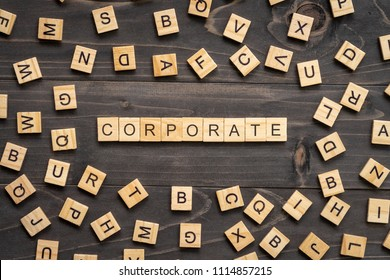 Corporate word wood block on table for business concept.