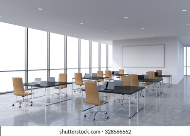 Corporate workplaces equipped by modern laptops in a modern panoramic office, white copy space in the windows. Brown leather chairs and a black tables, a huge whiteboard on the wall. 3D rendering.