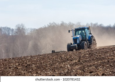 Corporative Rural dawns, Land cultivation by tractors, Spring field works. Russia Tatarstan. Zainsky district. 06.03. 2018 year