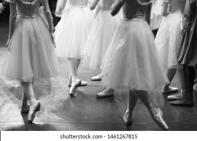 Corps de ballet actresses in the theater rehearsal hall in costumes and pointe