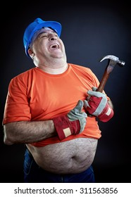Corpulence construction worker with helmet and hammer laughing loudly.