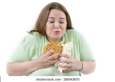 Corpulent woman having addiction to unhealthy food. Happy holding some high calories food.
