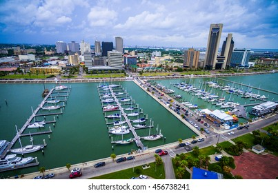 Corpus Christi Texas bayfront Skyline view of City with many rows of piers filled with boats and sailboats and yachts across the summer vacation landmark getaway