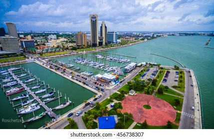 Corpus Christi Texas Skyline view of City harbor bridge in background  with many rows of piers filled with boats and sailboats and yachts across the summer vacation landmark getaway
