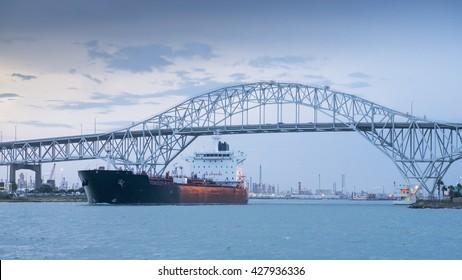 CORPUS CHRISTI, TEXAS, USA - SEPTEMBER 21, 2013:The iron road bridge and oil tanker on September 21, 2013 year.