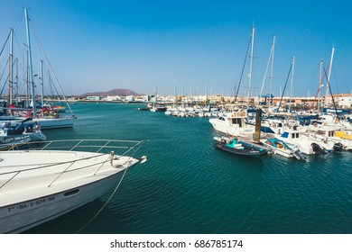 Corralejo, Fuertevetura Island, Spain - April 01, 2017: The skyline of Corralejo with the port and boats in it