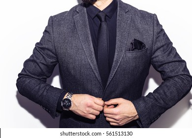 correct button on jacket, hands close-up, dressing, man's style, stylish man.Elegant young handsome man. Studio fashion portrait.Not isolated