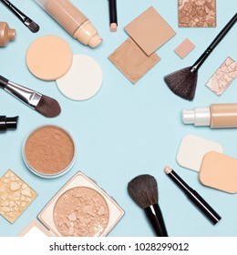 Corrective makeup set. Concealers, primer, liquid fluid and cream foundation with correcting, bronzing, highlighting, shimmer powder, make-up brushes and sponges. Flat lay, copy space