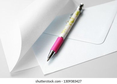 Correspondence Set: Blank Sheet of Paper with Curled Corner, Envelope and Pen