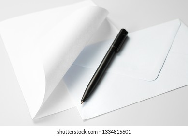 Correspondence Set: Blank Sheet of Paper with Curled Corner, Envelope and Black Pen